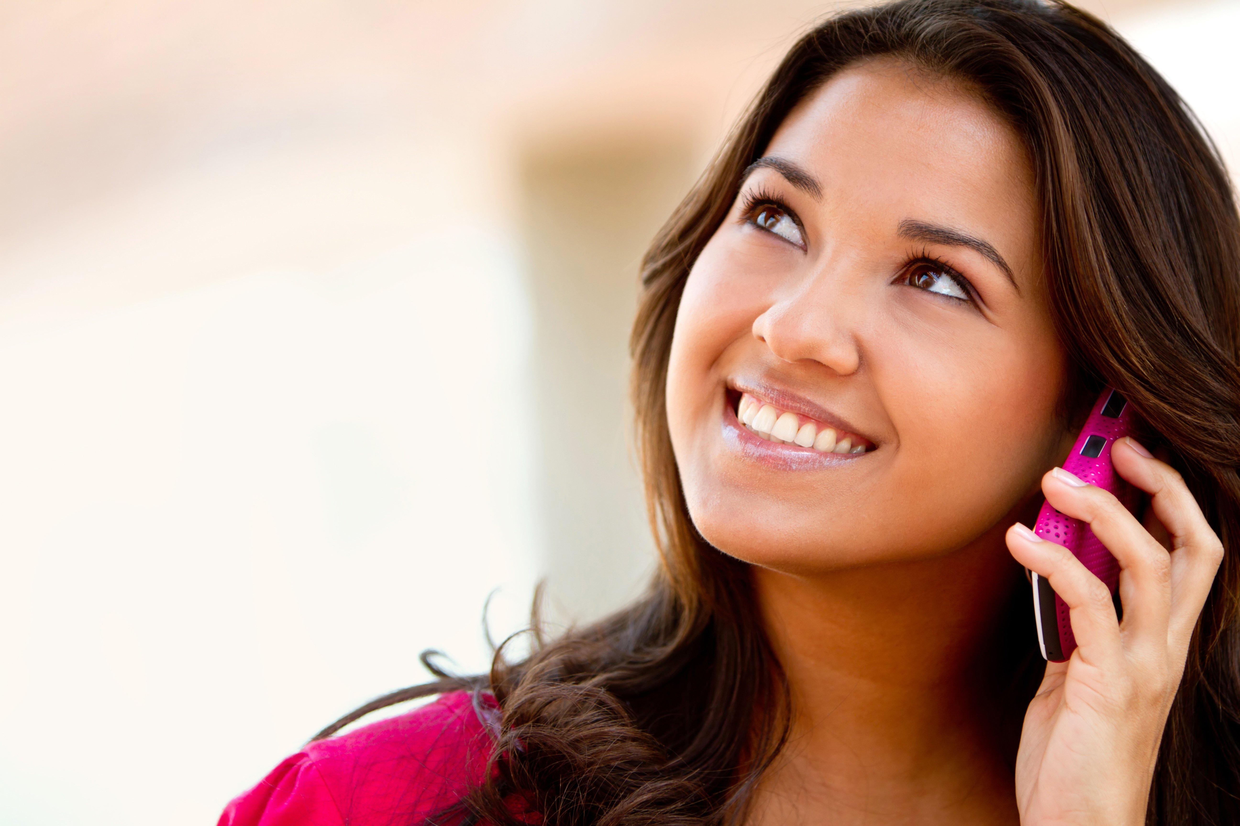 girl smile w pink phone.jpg