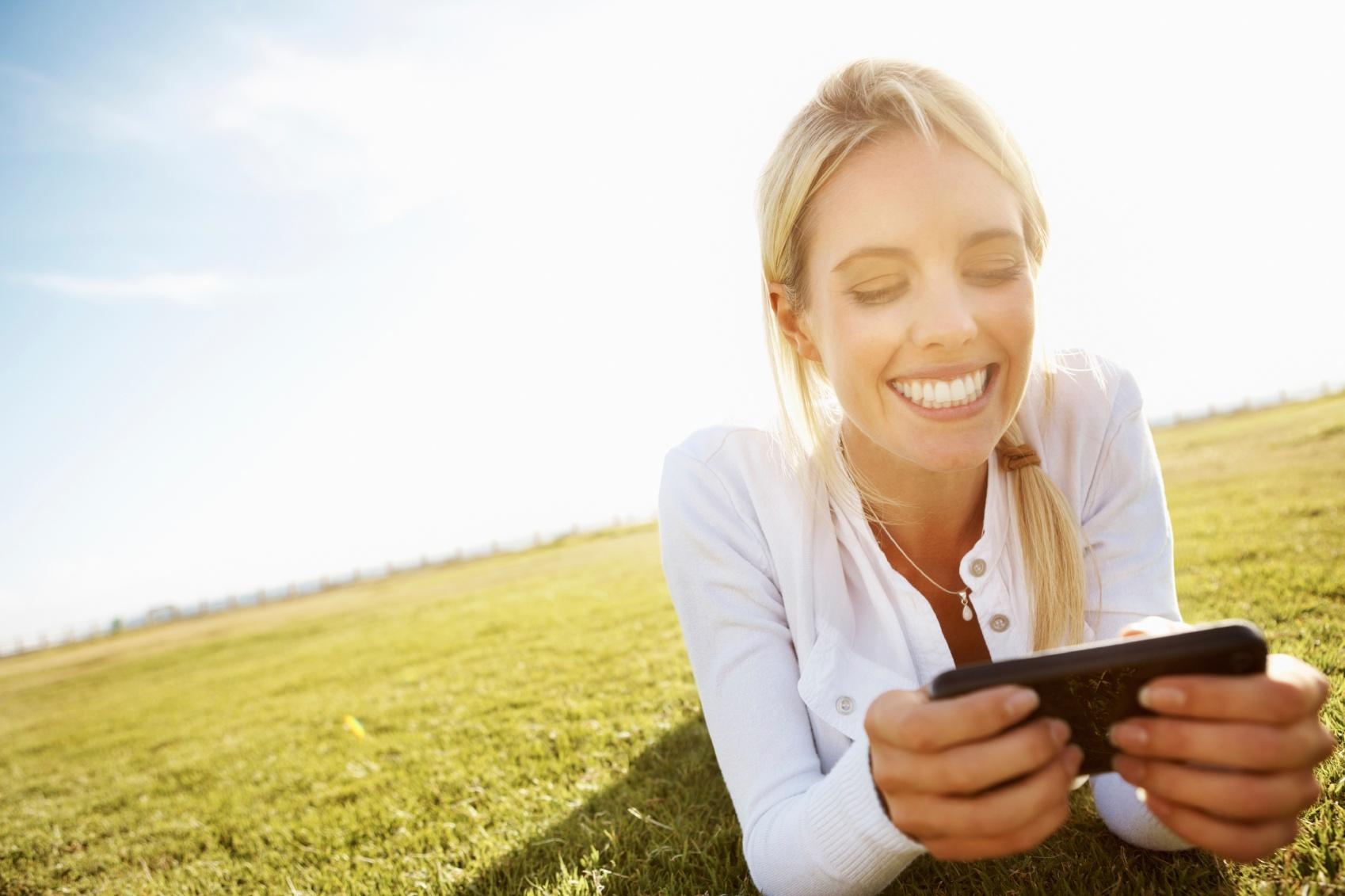 woman on grass texting.jpg